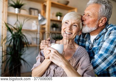 Mature Couple Hugging And Relaxing At Home Together