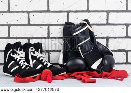 Concept Of Sports Stuff For Martial Arts On A Gray Brick Background