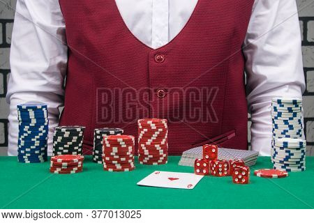 A Set For Gambling Lies On A Green Cloth: Poker Chips, A Deck Of Cards And Dice