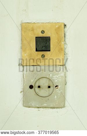 Vintage Electricity Socket And And A Switch.