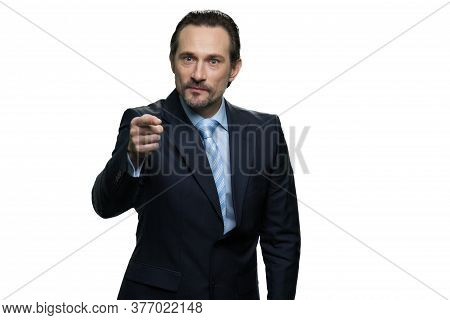Serious Mature Chief Pointing With His Finger. Confident Businessman Isolated On White Background.