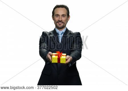 Smiling Chief In Costume Giving A Present. Middle-aged Director Holding A Present In Yellow Box. Suc