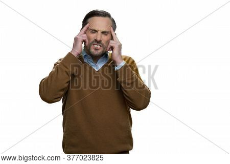 Middle-aged European Man Has A Headache. Portrait Of Sick Man With Headache Isolated On White Backgr