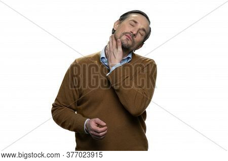 Portrait Tired Middle Aged Man With Neck Pain. Casual-dressed Mature Man With Spasm Of Neck Isolated