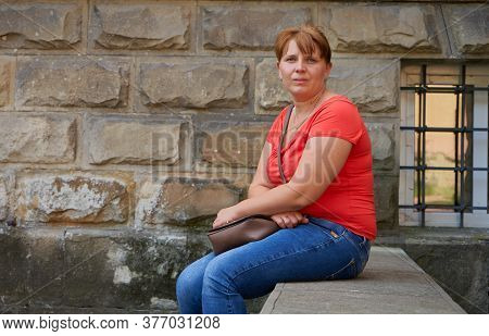 Woman Sitting Near The Educational Institute, Woman Sitting On A Stone Staircase Near The Building A