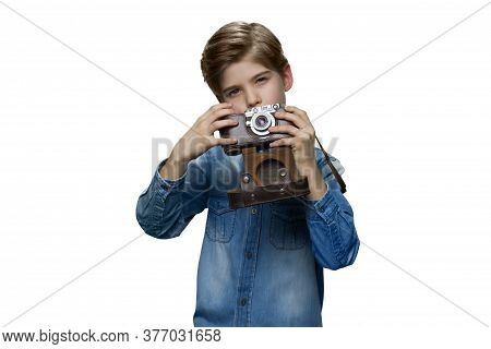Young Child With Retro Camera. Little Boy In Blue Denim Clothes. Taking Pictures With A Camera Again