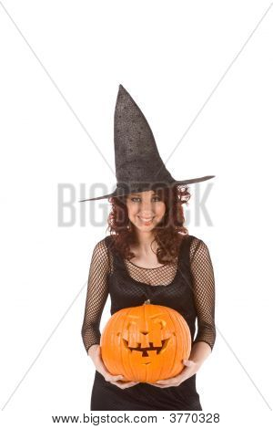 Teenaged Girl In Halloween Costume With Pumpkin