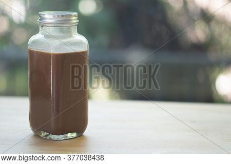Coffee Mocha In Glass Bottle On Wood Table