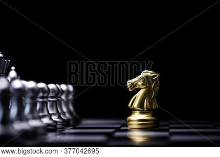 Golden Horse Chess Encounters With Silver Chess Enemy On Chess Board And Black Background. Market Or