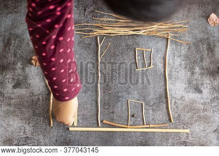 Little Girl Making A House With Sprigs Of Plants