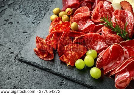 Set Of Salami, Chorizo, Coppa, Lomo, Beef, Meat Antipasto Platter On Stone Board