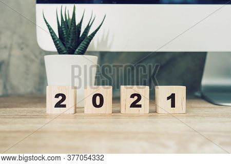 2021 Happy New Year On Wood Block On Wood Table Desktop Computer And Pot Plant. New Year Concept
