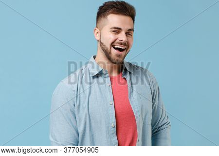 Cheerful Funny Young Bearded Guy 20s In Casual Shirt Posing Isolated On Pastel Blue Background Studi