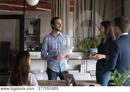 Smiling Diverse Colleagues Have Fun Talk In Office
