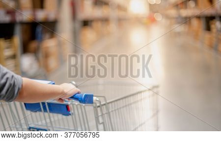 The Female Hand Pushing The Trolley Cart Shopping The Decorate Funiture For Interior Inside The Hous