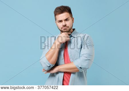 Puzzled Pensive Young Bearded Guy 20s In Casual Shirt Posing Isolated On Pastel Blue Wall Background
