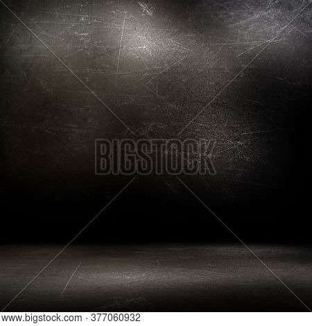 Grunge style room interior with dark scratched walls and floor