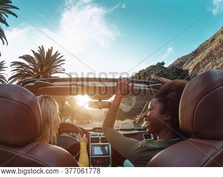 Young Happy Women Doing A Road Trip In Tropical City - Travel People Having Fun Driving In Trendy Co