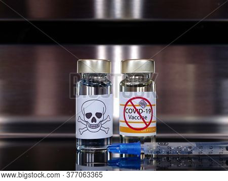 Two Bottle One With A Skull And One Vial Vaccine Anti-vax Activists Covid-19 And Syringe . Coronavir