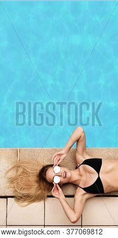 Top View Of Pretty Girl In Stylish Bikini Sunbathing At Poolside, Empty Space
