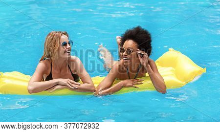 Summer Fun Together. Best Girl Friends Floating On Lilo And Laughing At Outdoor Swimming Pool, Panor