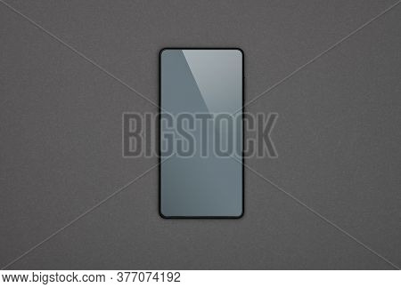 Close Up One Black Smartphone With Blank Screen Over Grey Paper Background, Flat Lay, Directly Above
