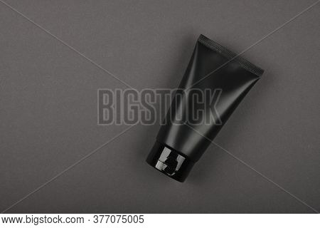 Close Up Men Grooming Product, Personal Care Cream, Lotion Or Gel In Black Tube On Gray Table, Eleva