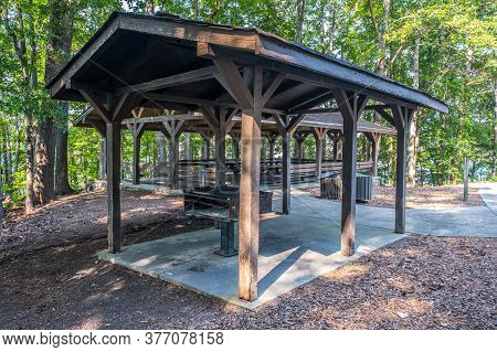 A Picnic Pavilion With A Large Grill For Big Gatherings Under A Shelter With A Water Spigot And Garb