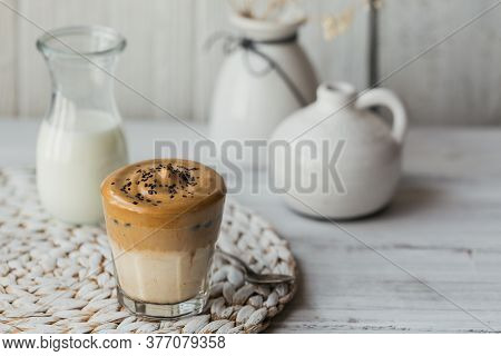 Dalgona Whipped Coffee, Instant, Cream, Iced Coffee. Cocktail With Coffee, Milk And Ice Cubes On Whi
