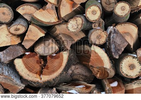 Pile Of Harvested Firewood For Winter Neatly Stacked, Closeup