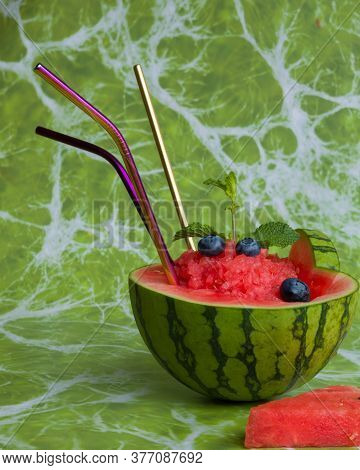 Juice In A Watermelon And Straws To Drink It.