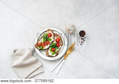 Italian Food, Bruschetta With Ricotta Cheese, Basil And Tomato On Plate. Top View