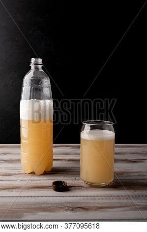 Misted Plastic Bottle Of Beer Or Light Rye Kvass With Glass Cup With Foam. Selective Focus. Wonderfu
