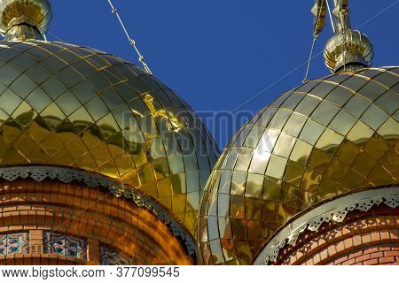 Golden Church Domes Against A Blue Sky. Domes Of A Religious Institution.