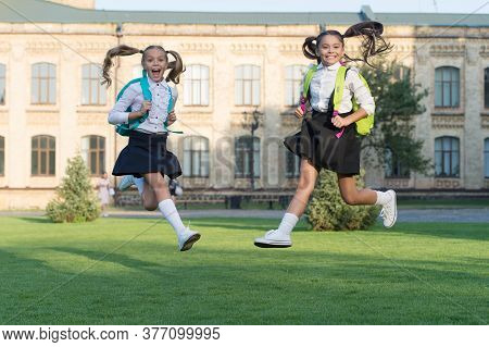 Excited Happy Girls School Uniform Jumping, Sincere Happiness Concept.