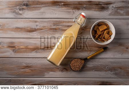 Top View Homemade Tradishional Russian Light Rye Kvass In Bottle And Crackers On Wooden Background.