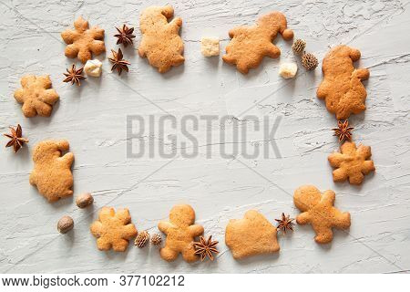 Homemade Festive Gingerbread Cookies On Grey Concrete Background, Space For Text, Copy Space.
