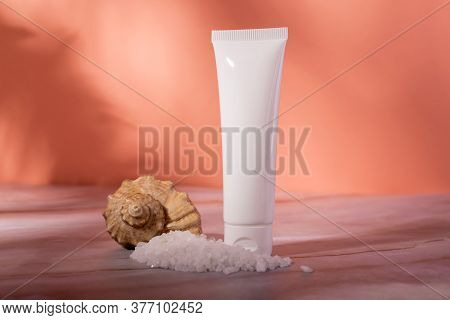 Sea Salt Skin Care Cosmetics Bottle On A Marble Background. Dead Sea Natural Cream Package Mockup.
