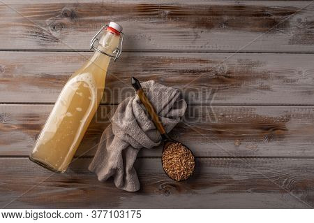 Top View Homemade Tradishional Russian Light Rye Kvass In Bottle And Linen Napkin On Wooden Backgrou