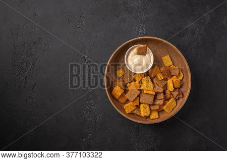 Top View Plate With A Set Of Croutons With And Horseradish On A Dark Graphite Background. Popular Ap