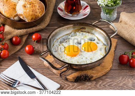 Traditional Turkish Breakfast - Fried Egg, Bread, Tomato And Tea