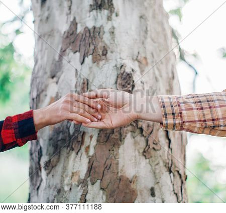 Romantic Young Loving Couple Holding Hands. Love Couple.