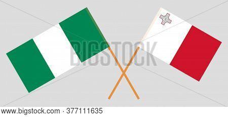 Crossed Flags Of Nigeria And Malta. Official Colors. Correct Proportion. Vector Illustration