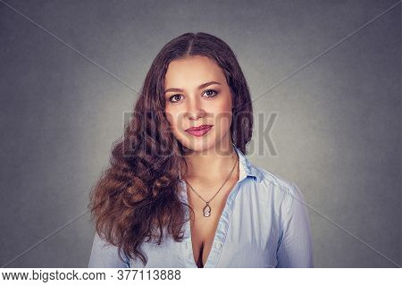 Happy, Cheerful, Smiling Woman Isolated On Studio Gray Background. Model Girl With Long Wavy Curly H
