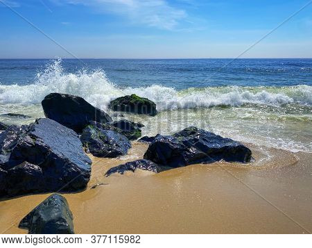 Crashing Waves On The Rocks In Long Branch Along The Jersey Shore.