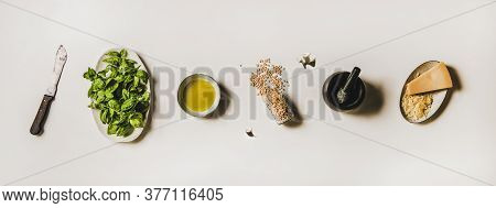 Ingredients For Cooking Italian Pesto Sauce Over White Background