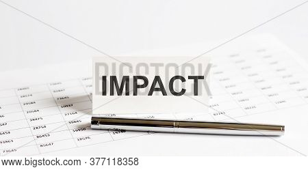 Text Impact On Stickers,pen On The Background Of Documents. Financial Bookkeeping, Accounting Concep
