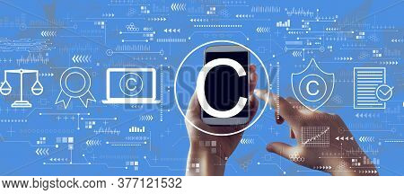 Copyright Concept With Person Holding A White Smartphone