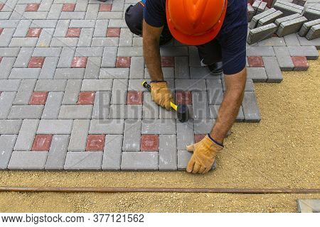 Professional Bricklayers Install New Tiles Or Slabs For The Roadway, Sidewalks Or Patio On A Foundat