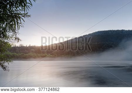 Sunrise Over A Misty River In Siberia In Summer. Beautiful Natural Landscape. Peace And Tranquility,